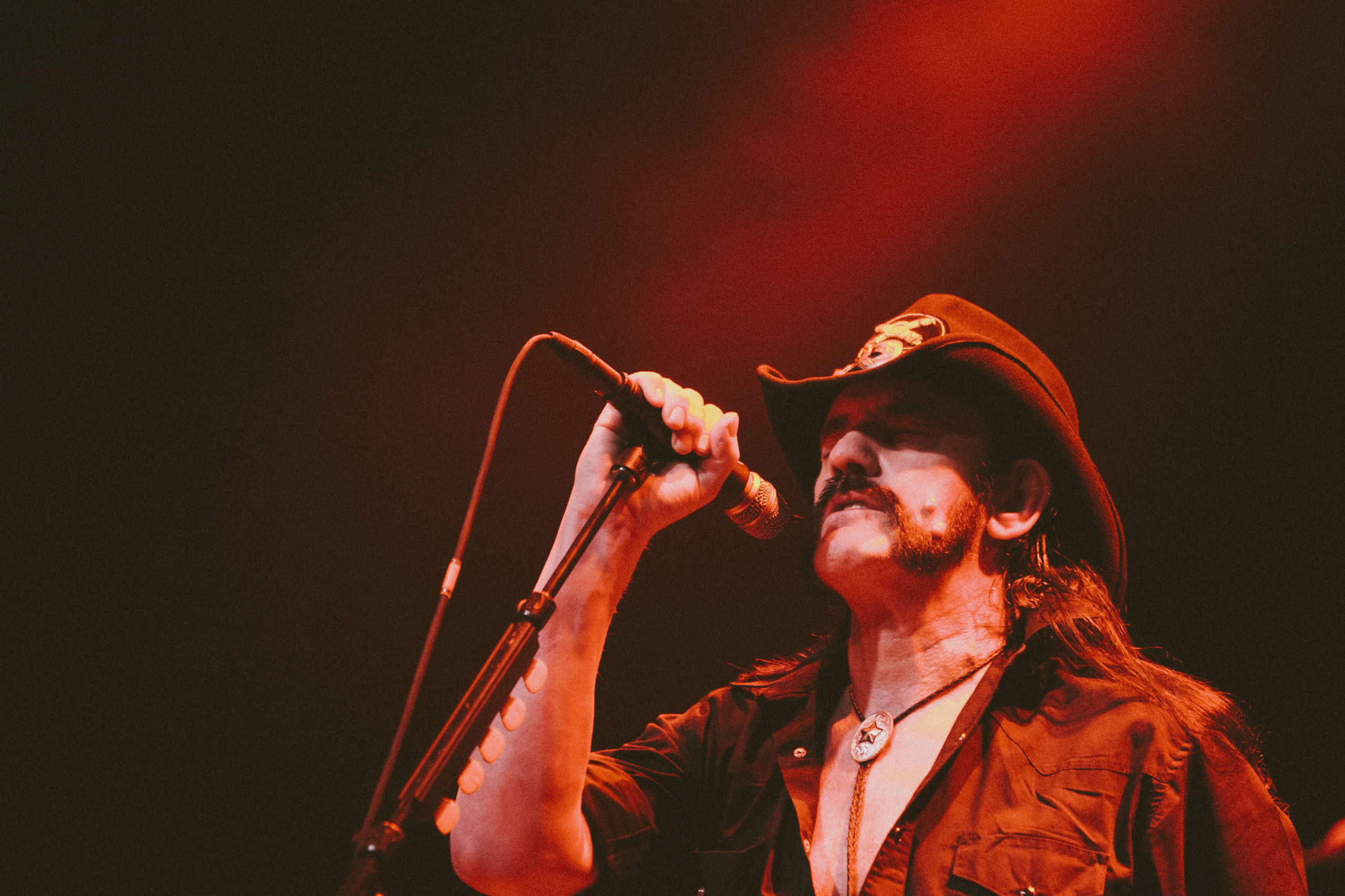Lemmy from Motorhead performs at Austin Music Hall during SXSW 2010, bathed in red stage light