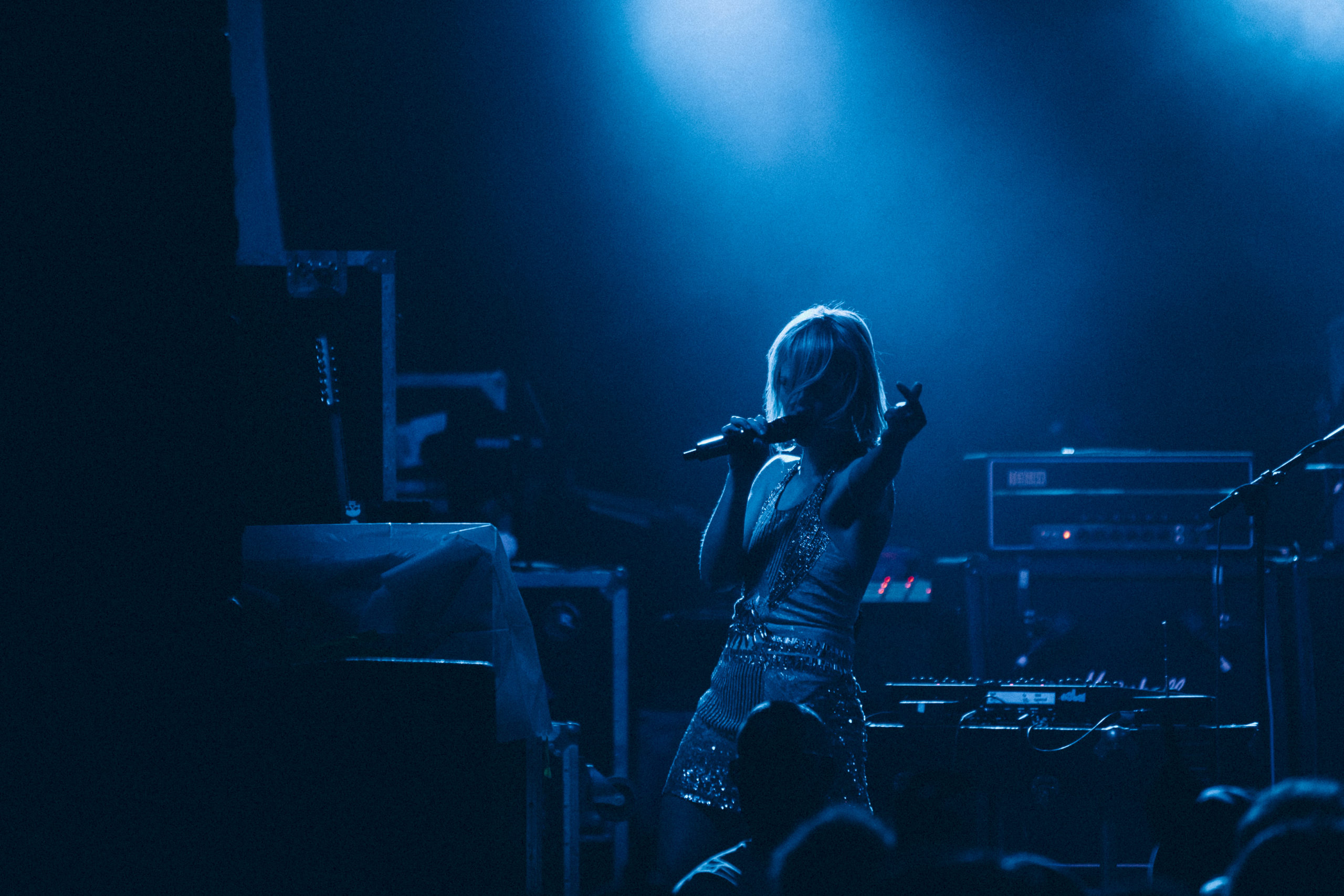 Metric performs at Subb's BBQ during SXSW 2010 with the stage bathed in blue light.