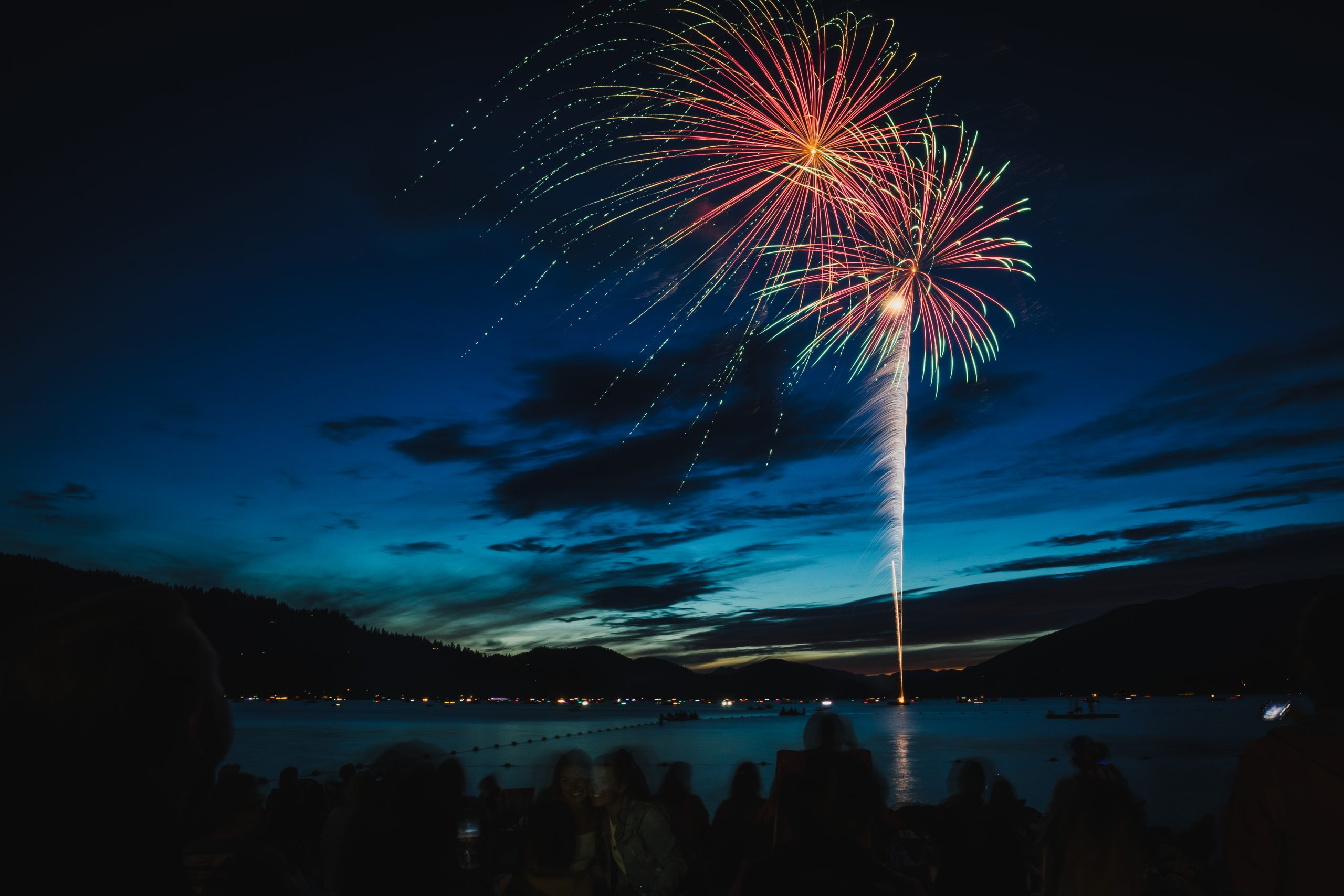 Fireworks explode in the sky above Whitefish Lake during the 4th of July celebrations in Whitefish, Montana.