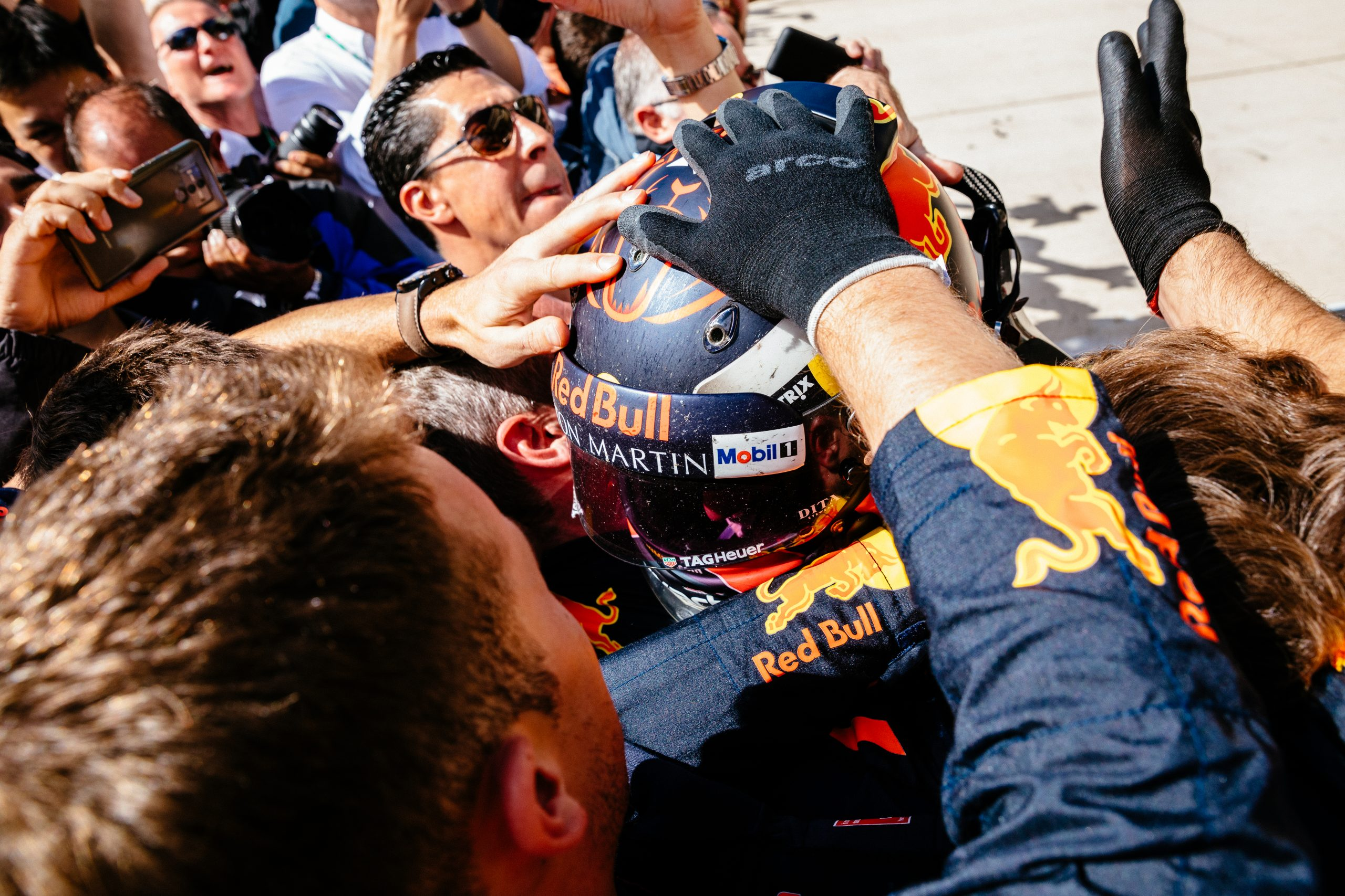 Max Verstappen celebrates with his team after a stellar drive from 18th to 2nd, something extremely rare in Formula 1.