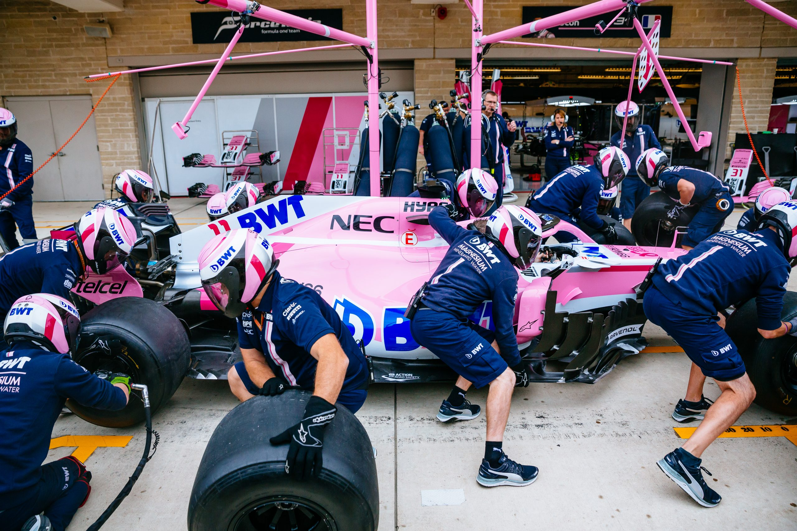 Prior to the start of FP3, the team performs several repetitions of pit stop practice by rolling the car into the pit box and performing different tasks like changing the tires. This practice is what helps them do pitstops in under three seconds on a regular basis.