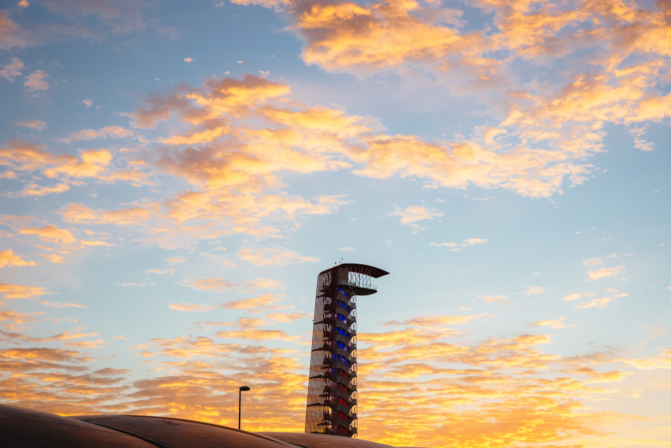 The iconic COTA Tower at sunrise on race day. Just because this is a motorsport event doesn't mean you can have a typical Texas Highways landscape.