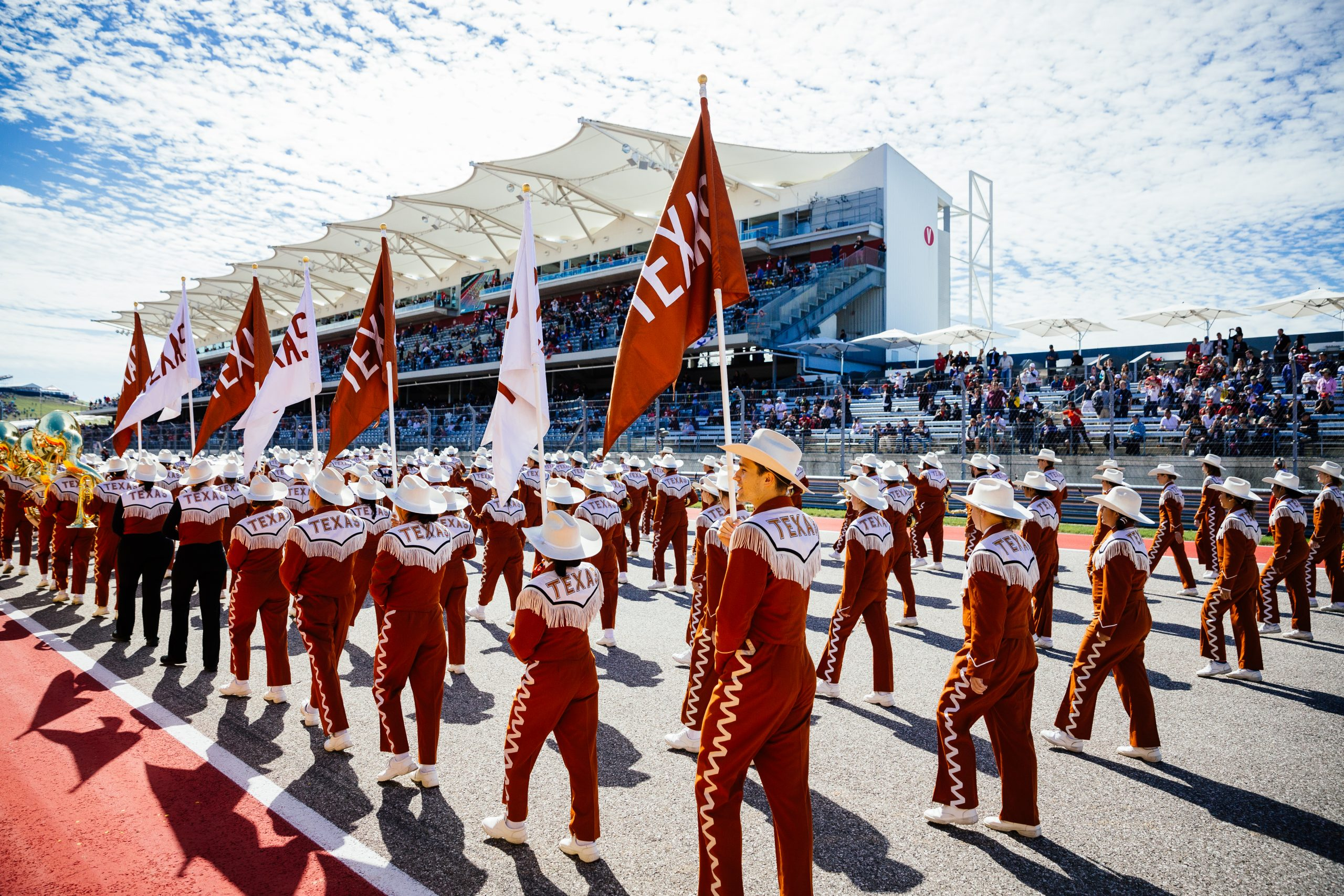 The University of Texas Longhorn Show Band performing on track prior to the race.