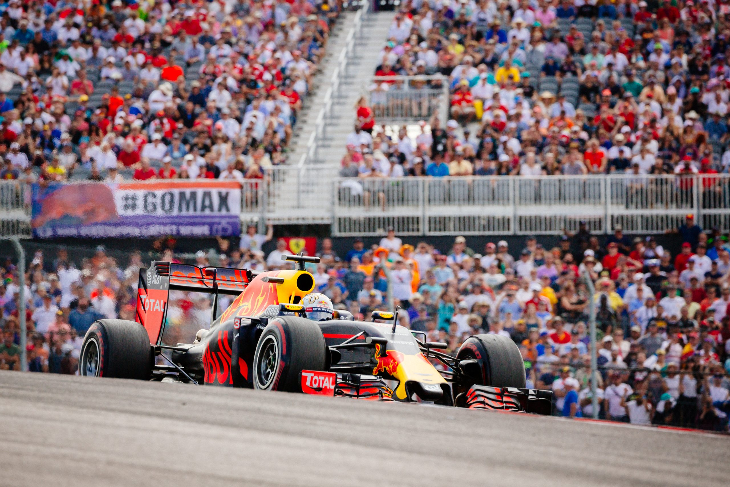 Daniel Ricciardo crests the hill of exiting Turn 1 at Circuit of the Americas during the 2016 F1 United States Grand Prix.