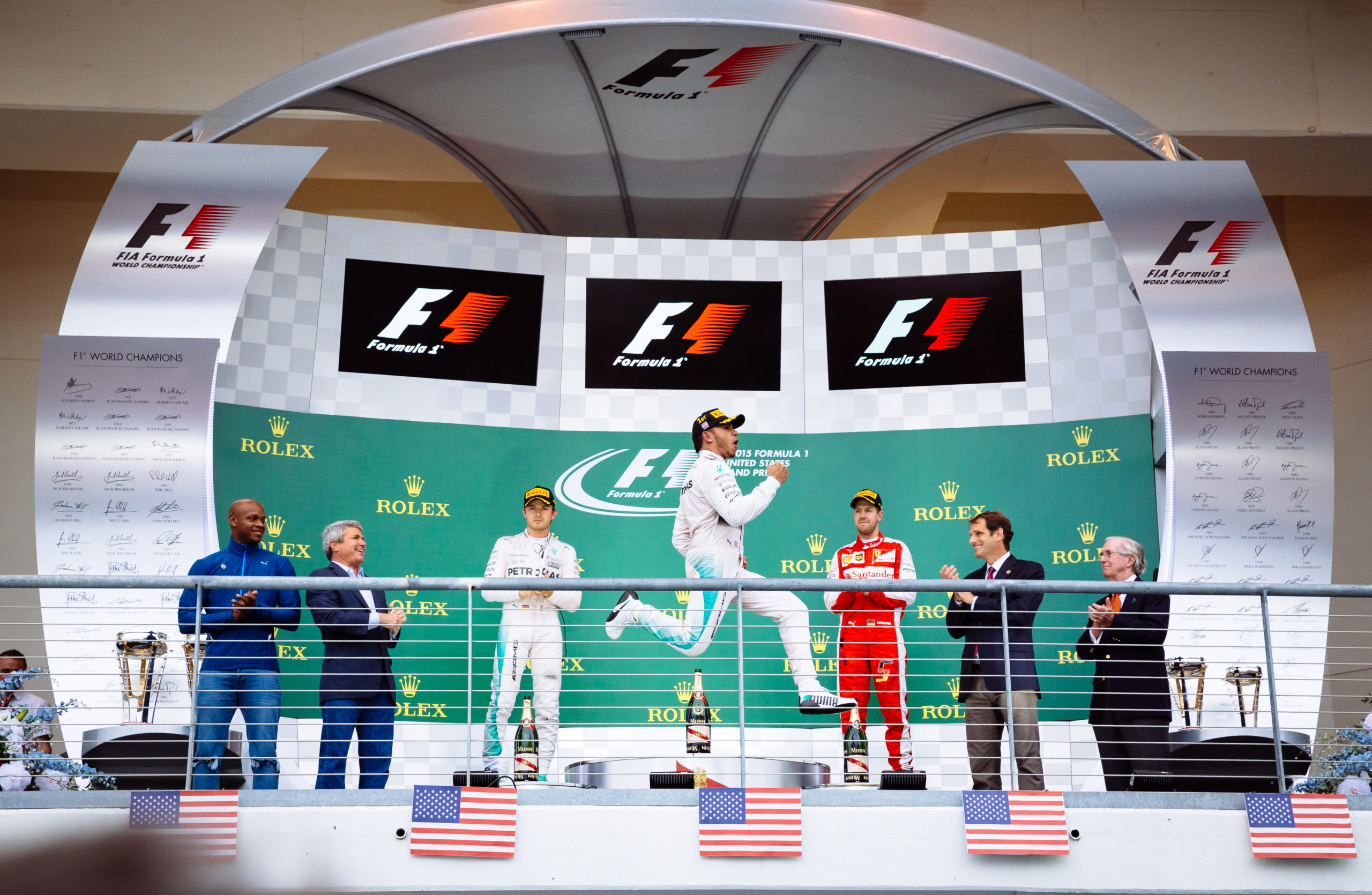 Lewis Hamilton celebrates his race win at the 2015 United States Grand Prix which secured his 5th Drivers' championship.